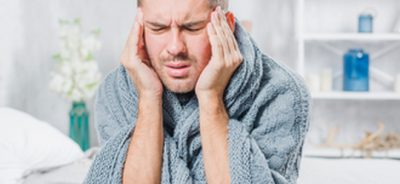 young man suffering from-cold-having-headache
